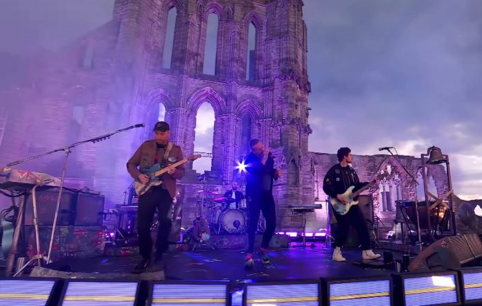 Coldplay performing Higher Power