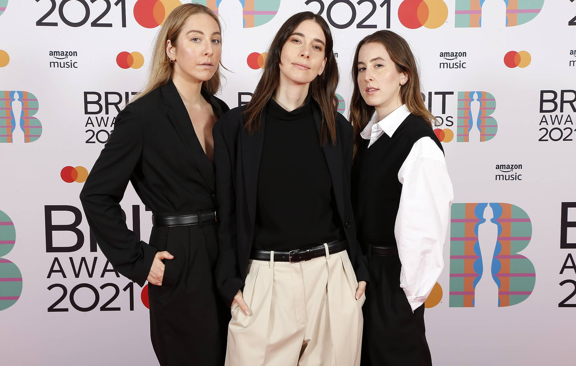 Este Haim, Danielle Haim,and Alana Haim of Haim pose in the media room during The BRIT Awards 2021 at The O2 Arena on May 11, 2021 in London, England. (Photo by JMEnternational/JMEnternational for BRIT Awards/Getty Images)