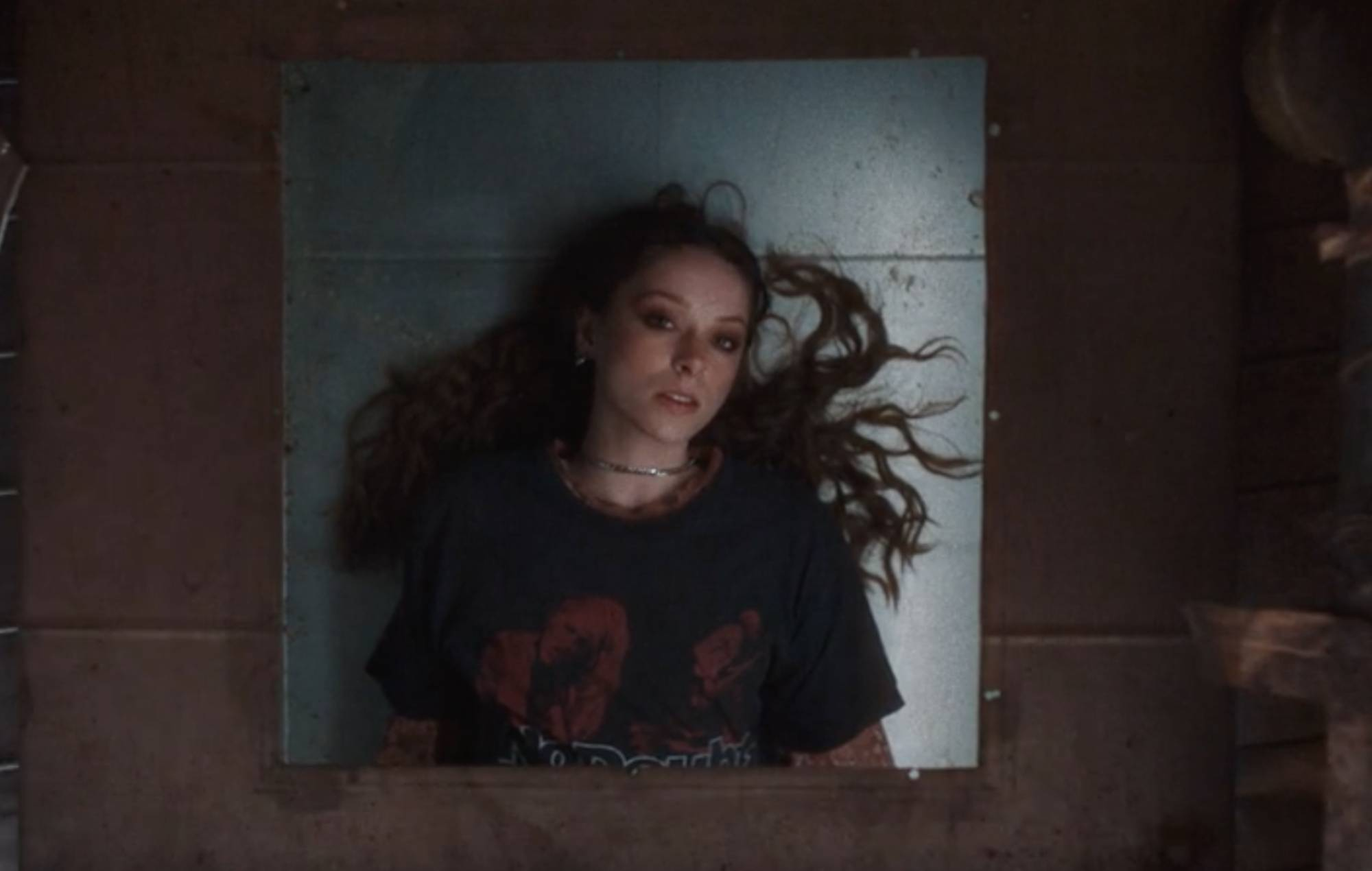 Watch Holly Humberstone's claustrophobic video for new single 'The Walls Are Way Too Thin'