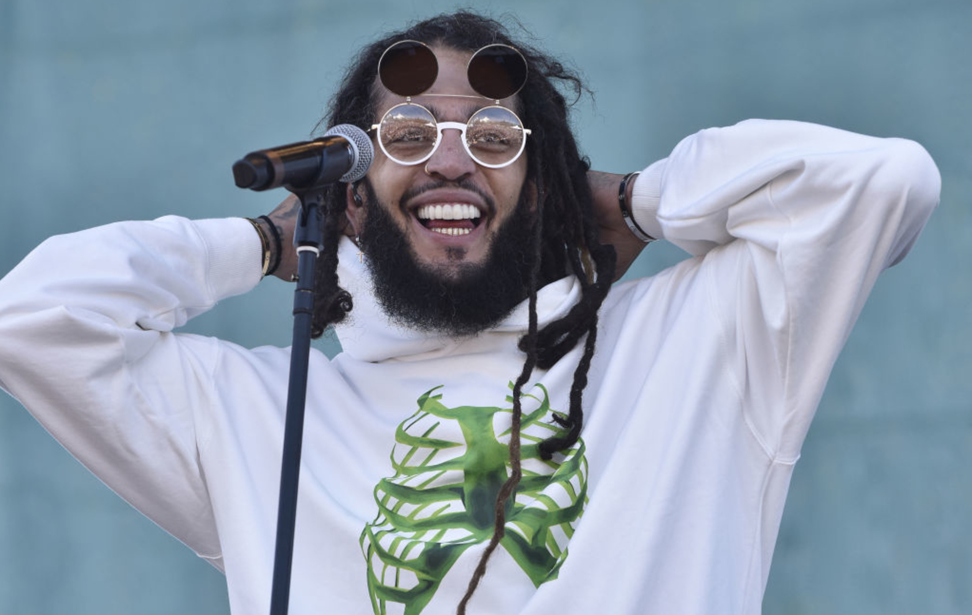 Travie McCoy signs to Hopeless Records, shares new song 'A Spoonful Of Cinnamon'
