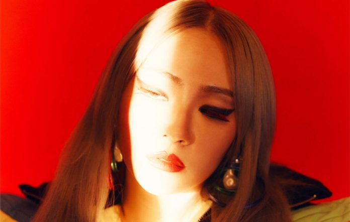 2ne1 cl advice younger alpha delay release date