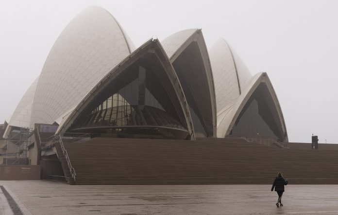 A person exercises at the Sydney Opera House in June as lockdown restrictions continue.