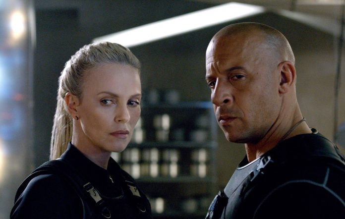 Charlize Theron and Vin Diesel as Cypher and Dom