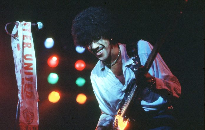 Phil Lynott performs with Thin Lizzy