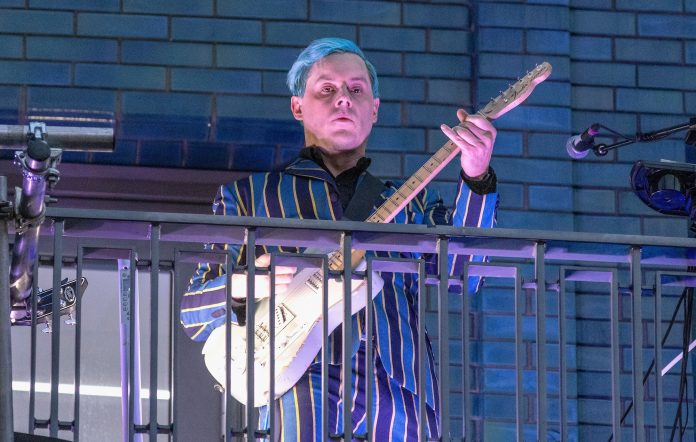 Jack White performs from a balcony on Marshall Street