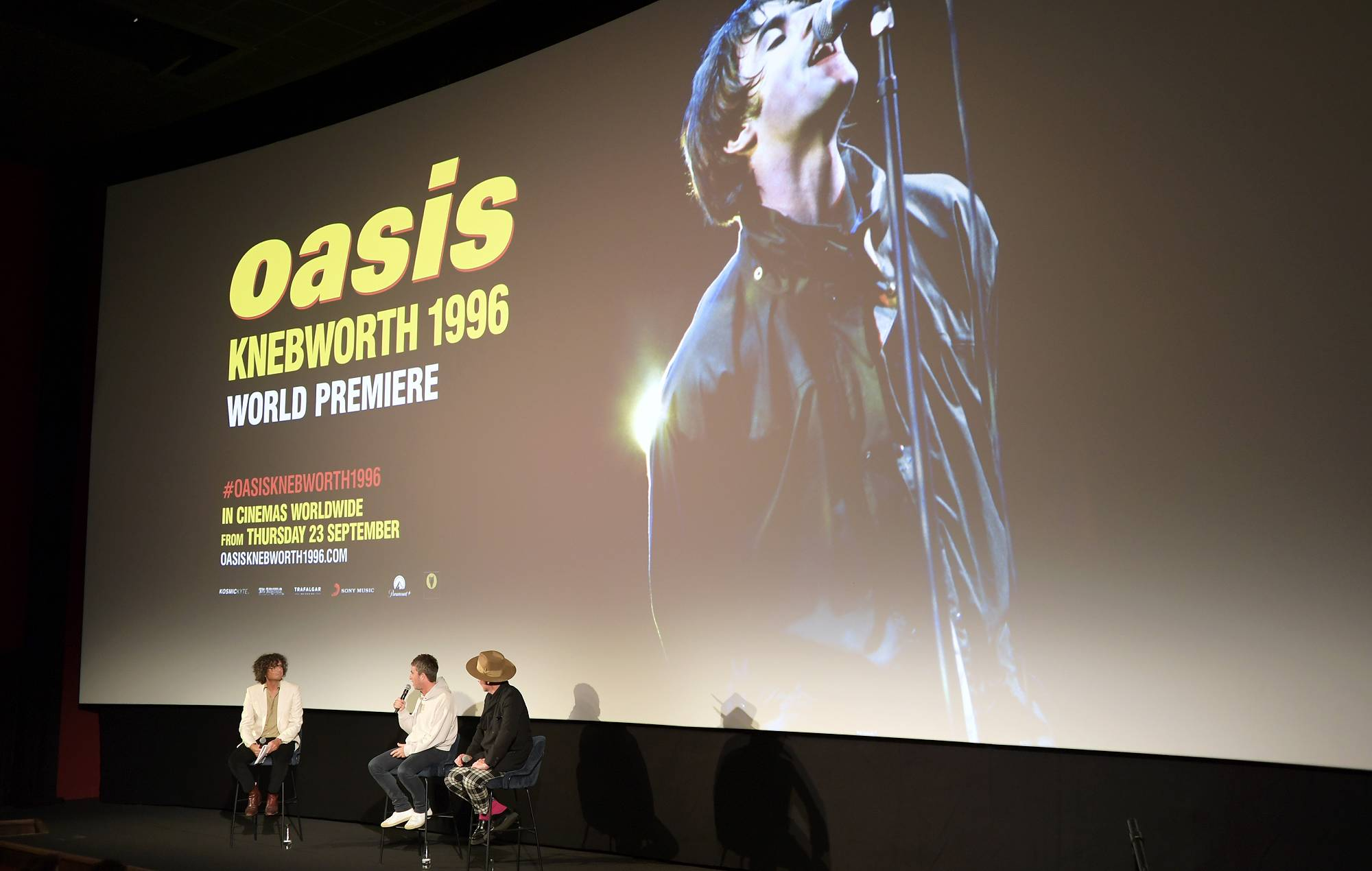 """Moderator Will Hodgkinson, Noel Gallagher and Director Jake Scott attend the World Premiere of """"Oasis Knebworth 1996"""" at the Picturehouse Central on September 16, 2021 in London, England. (Photo by David M. Benett/Dave Benett/Getty Images for Trafalgar Releasing)"""