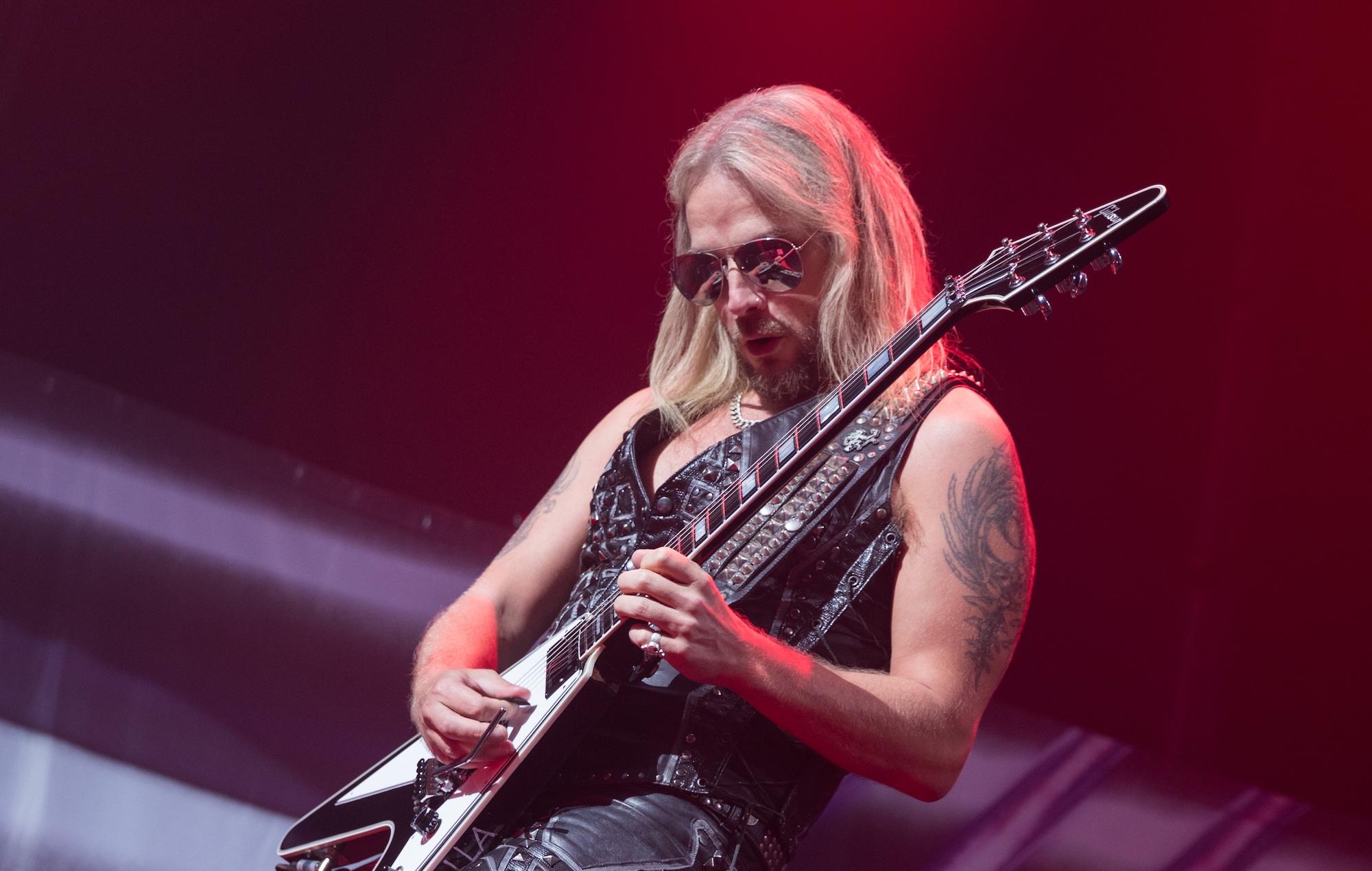 Richie Faulkner performs with Judas Priest