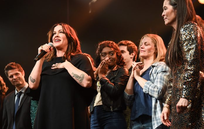 Alanis Morissette and cast pose during the curtain call of the opening night of the broadway show