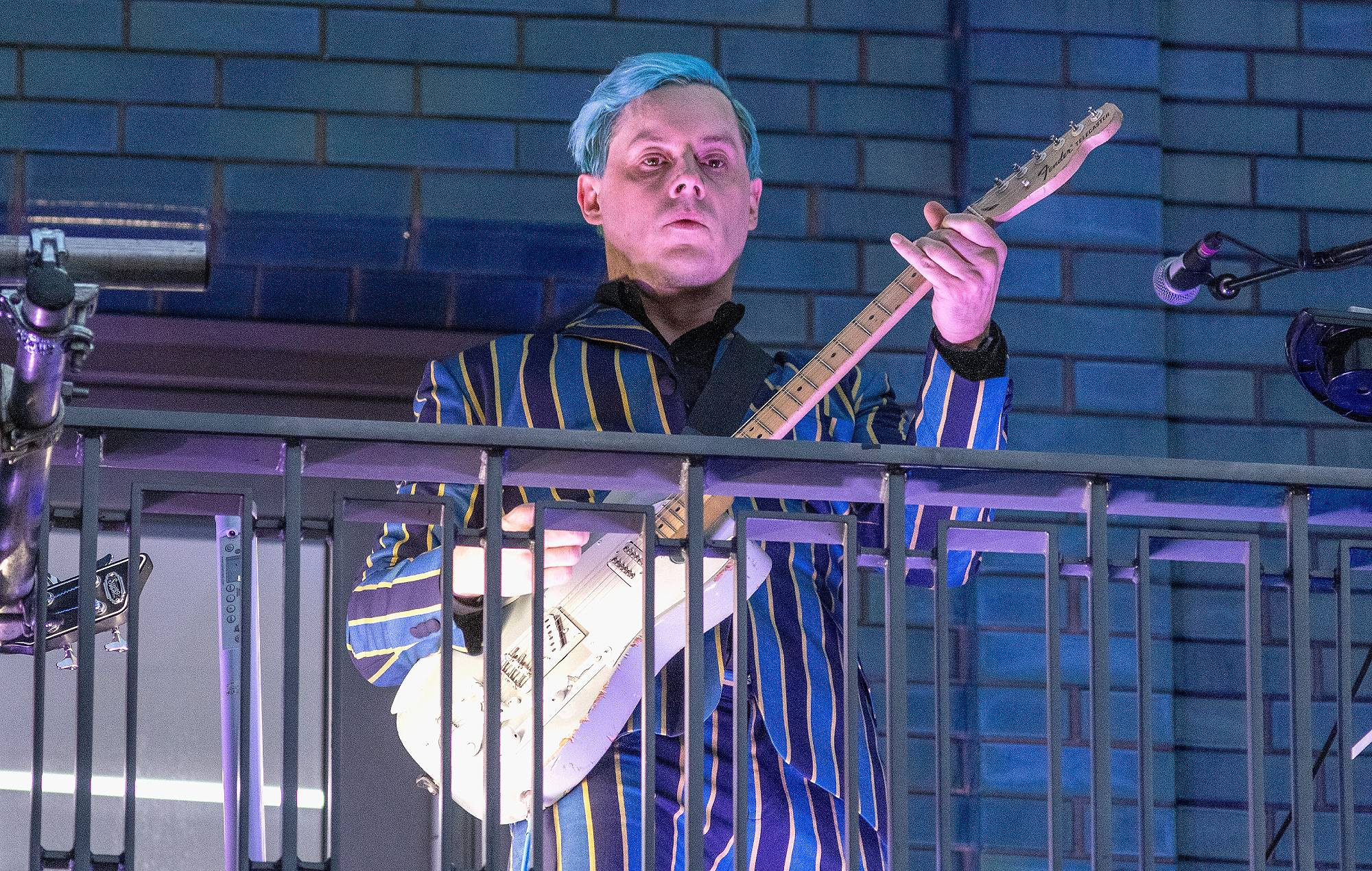 Jack White performs from a balcony on Marshall Street to crowds of people following his in store performance and opening of Third Man Records Store on September 25, 2021 in London, England. (Photo by Jo Hale/Getty Images)
